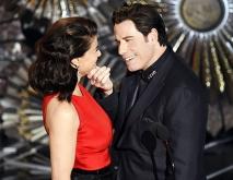 http://www.usmagazine.com/entertainment/news/john-travolta-idina-menzel-reunite-oscars-2015-mock-adele-dazeem-2015222